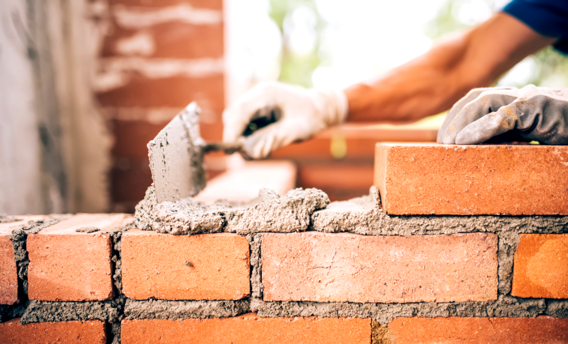 Man laying bricks - An introduction to website building software