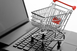 Shopping trolley on a computer keyboard{{}}