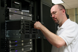Man working on server – managed hosting services