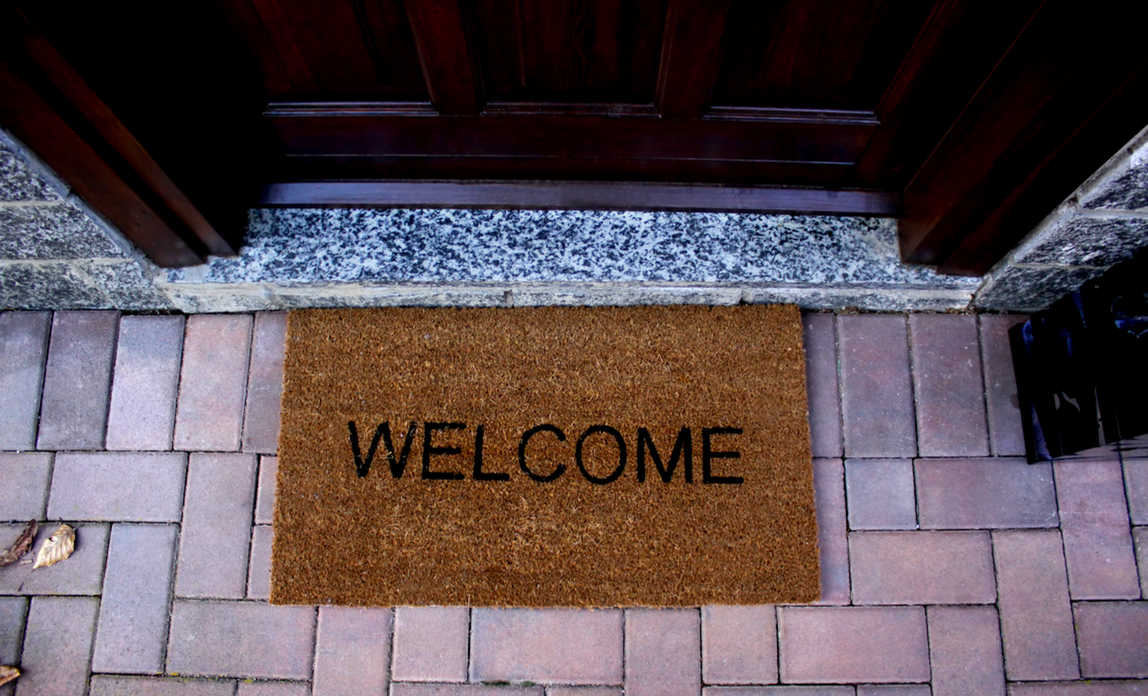 Welcome mat in front of door - Choosing a web host: what to check