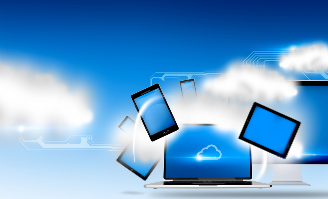 Laptop and tablets in a cloud graphic - Cloud hosting.