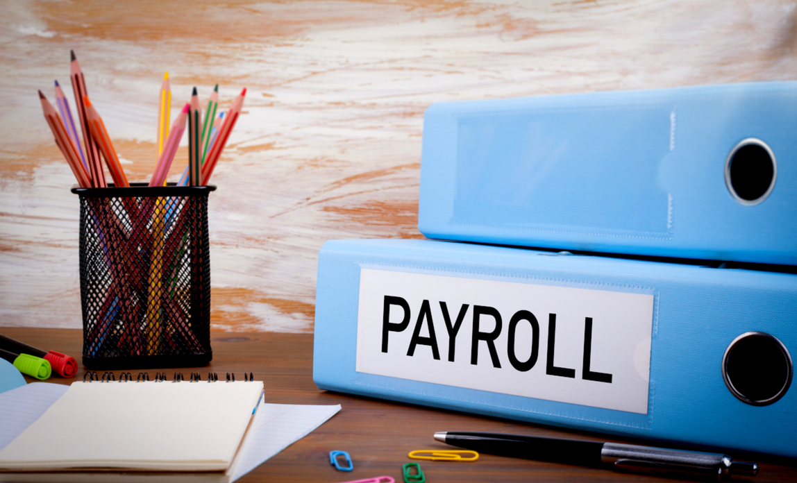 Payroll folder on a desk - do you need a payroll system?