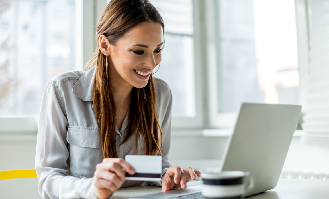 A young female customer buys from an online store while enjoying the user experience