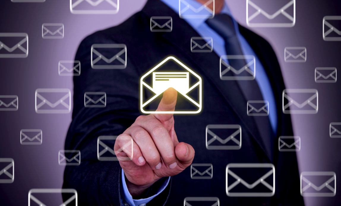 Man pointing at an email icon - free business email: right for your business?