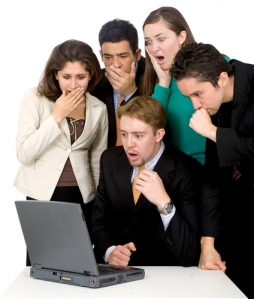 Business team looking shocked at computer