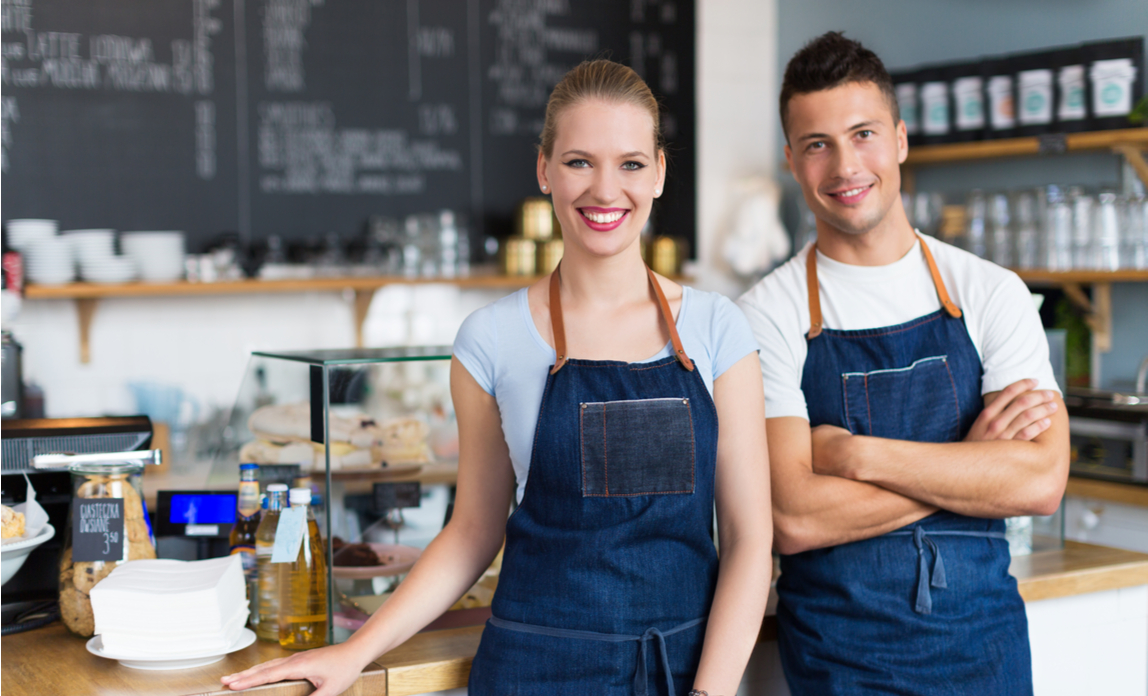 Small business owners in their cafe