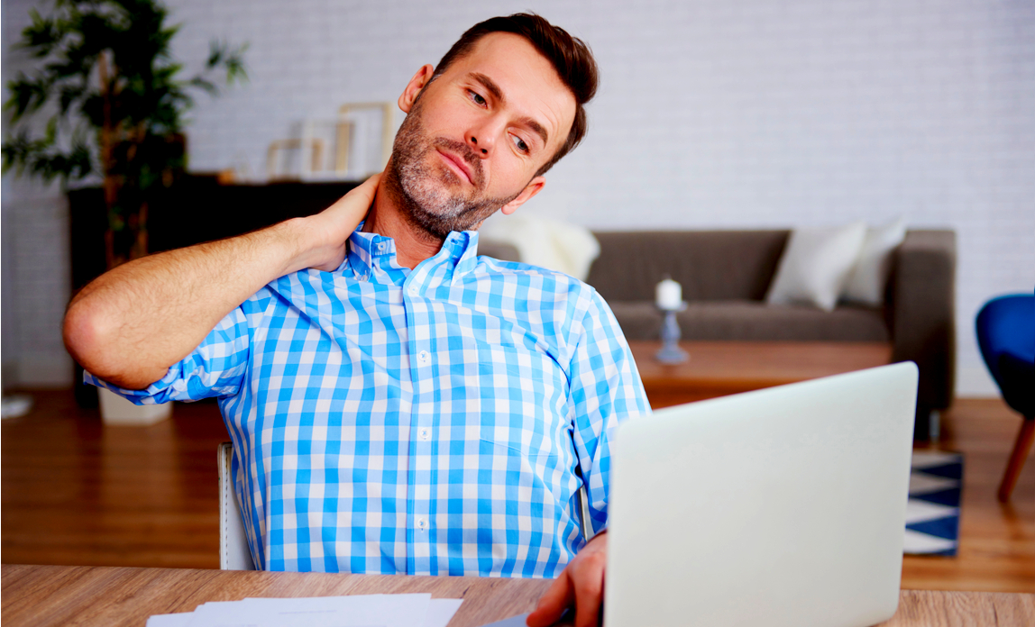 Mature entrepreneur suffering from neck pain