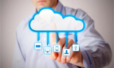 A man interacts with a cloud symbol representing various cloud services