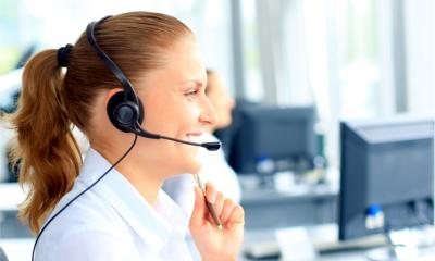 A woman offers remote technical support over the phone