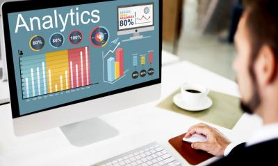 Man looking at web analytics on monitor - Monitoring your web traffic