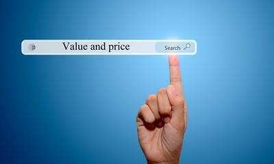 Person pointing to 'Value and price' written into a search bar