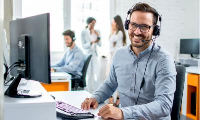 A call centre operative uses call tracking technology to offer better customer service.