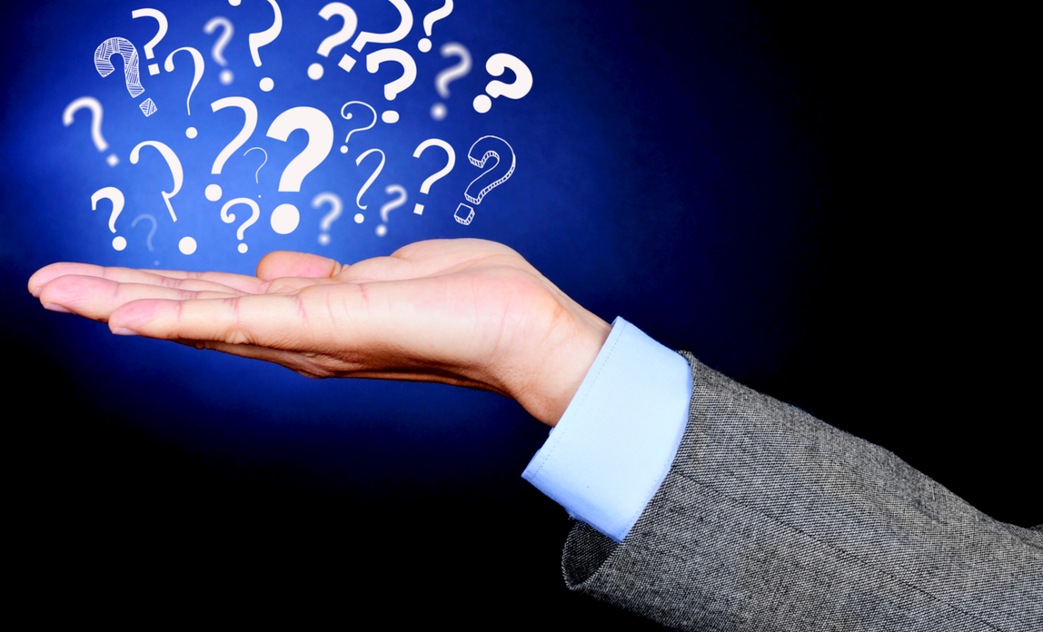 Man with question marks above extended hand - what to ask when choosing a support company.